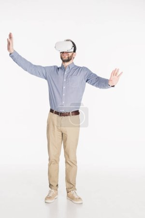 bearded man in virtual reality headset with outstretched arms isolated on white