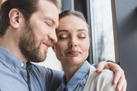 portrait of beautiful smiling couple with eyes closed