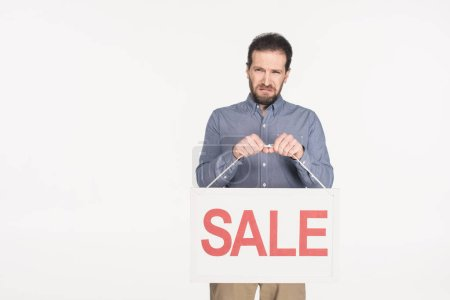 portrait of upset man with sale card isolated on white