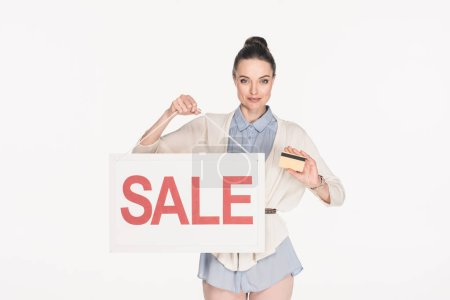 portrait of woman with sale sign and credit card in hands isolated on white