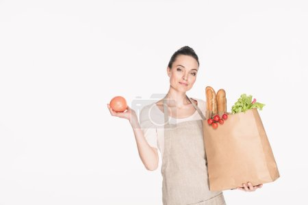 portrait of woman with paper package full of food isolated on white