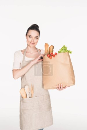 Photo for Portrait of woman with paper package with grocery isolated on white - Royalty Free Image