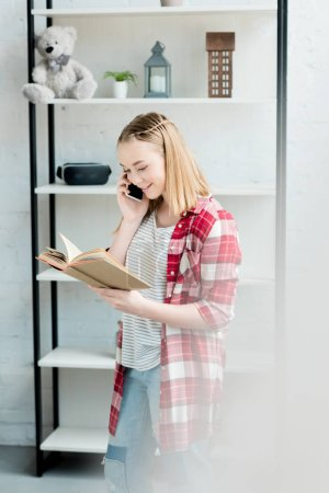 happy teen student girl reading book and talking by phone
