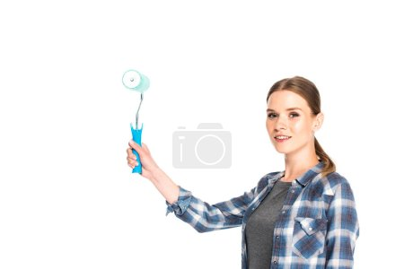 Photo for Young smiling woman holding paint roller isolated on white background - Royalty Free Image