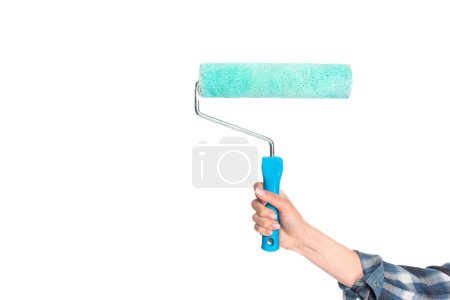 cropped image of woman holding paint roller isolated on white background