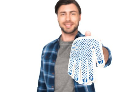 young man holding protective gloves isolated on white background