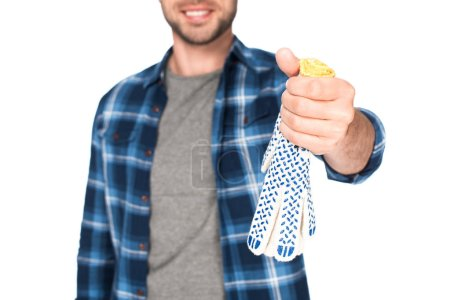 cropped shot of man holding protective gloves isolated on white background