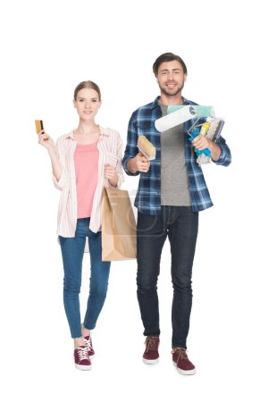 couple with credit card, shopping bag and painting tools isolated on white background