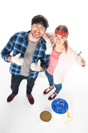 Photo for High angle view of smiling couple in protective gloves doing thumbs up gesture isolated on white background - Royalty Free Image
