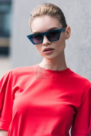 portrait of stylish young female model in sunglasses