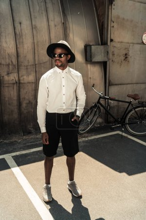 Fashionable african american man wearing fedora hat and sunglasses