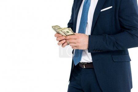 cropped shot of businessman in formal wear counting dollar banknotes isolated on white
