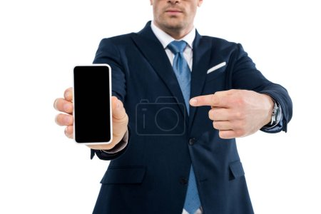 cropped shot of businessman pointing with finger at smartphone with blank screen isolated on white