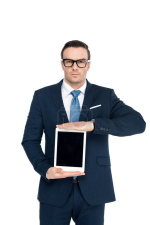 businessman in eyeglasses holding digital tablet with blank screen and looking at camera isolated on white
