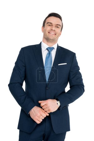 portrait of handsome middle aged businessman smiling at camera isolated on white