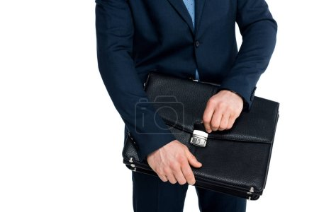 mid section of businessman in formal wear holding briefcase isolated on white
