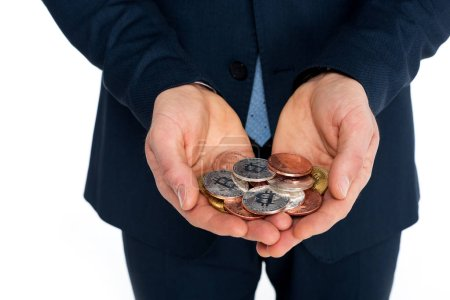 close-up partial view of businessman holding bitcoins isolated on white