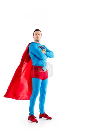 Photo for Full length view of confident superman standing with crossed arms and looking at camera isolated on white - Royalty Free Image