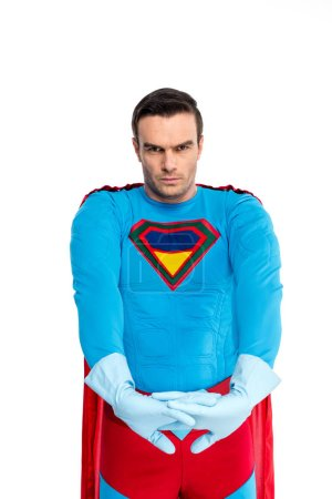handsome superhero in rubber gloves looking at camera isolated on white