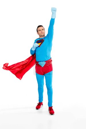 full length view of male superhero in rubber gloves raising hand and looking up isolated on white