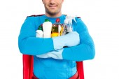 cropped shot of smiling superhero holding cleaning supplies isolated on white