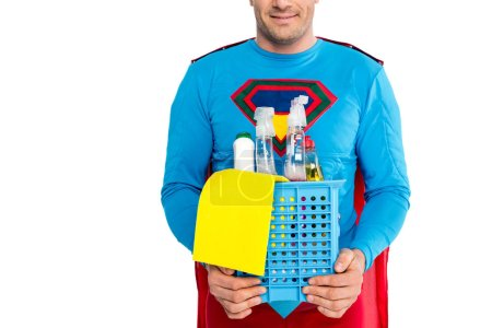 cropped shot of smiling superman holding cleaning items isolated on white