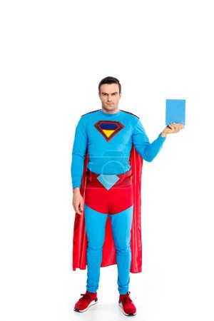 full length view of handsome superman holding soap powder and looking at camera isolated on white
