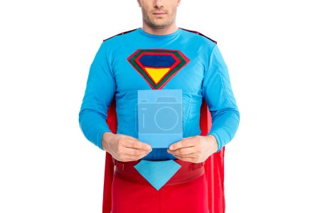 cropped shot of man in superhero costume holding blank box with soap powder isolated on white