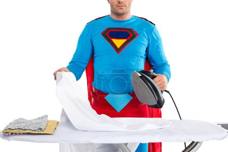 cropped shot of man in superhero costume ironing clothes isolated on white