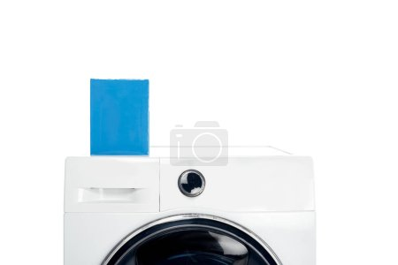 blank box with detergent on laundry machine isolated on white