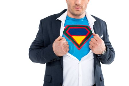 cropped shot of businessman showing superhero costume under suit isolated on white