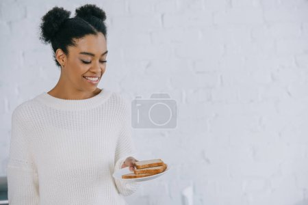 beautiful young woman with stack of bread slices on plate