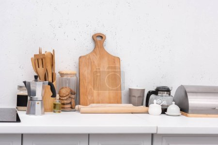 Photo for Various wooden kitchenware on table at kitchen - Royalty Free Image