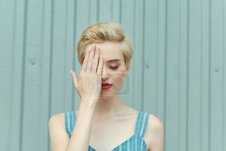 attractive girl with short hair posing with closed eyes