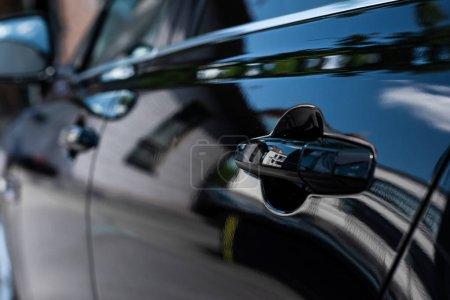 close up view of handle of black car door