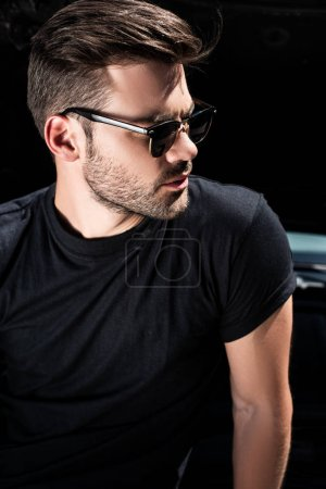 side view of stylish man in sunglasses in front of car with opened bonnet