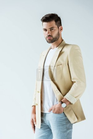 Fashionable confident man wearing jacket isolated on white background