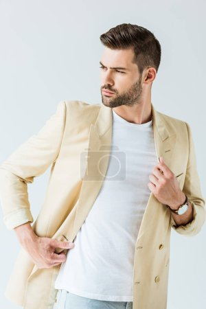 Photo for Fashionable confident man posing in beige jacket isolated on white background - Royalty Free Image