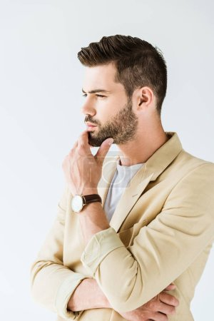 Fashionable confident man thinking with hand near face isolated on white background