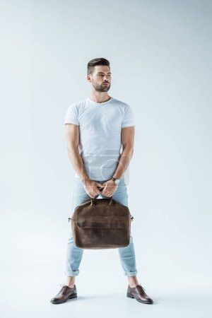 Handsome bearded man carrying briefcase on white background