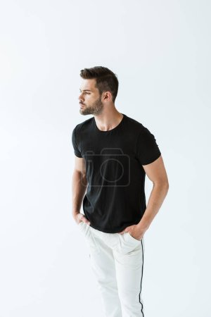 Handsome bearded man looking away isolated on white background
