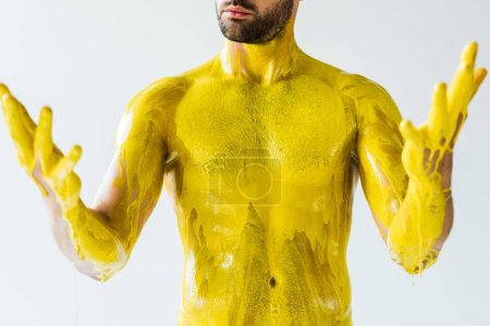 Male body and hands stained with yellow liquid isolated on white background