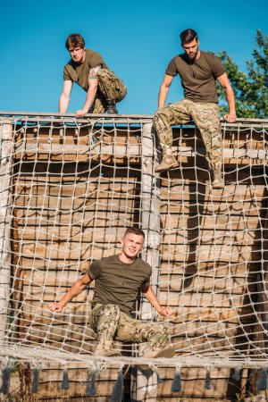 young soldiers practicing during obstacle run on range