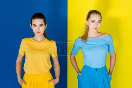 Pretty girls in summer clothes on blue and yellow background