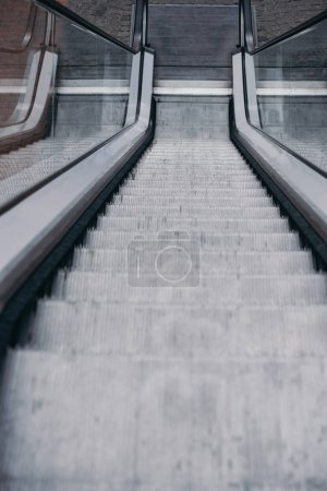 Photo for High angle view of grey moving staircase with stairs - Royalty Free Image