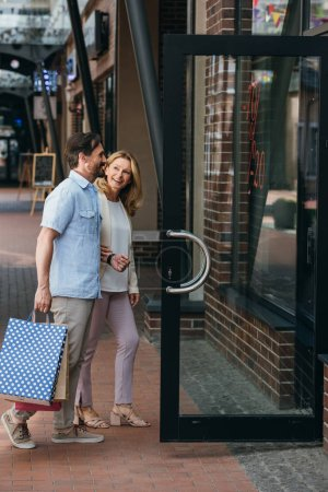 side view of couple entering shopping mall