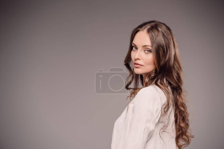 Photo for Beautiful woman looking at camera isolated on grey background - Royalty Free Image