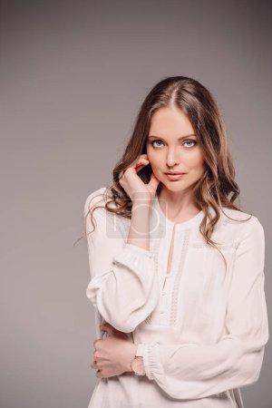 elegant female model posing isolated on grey background