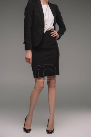 Photo for Cropped image of businesswoman posing on grey background - Royalty Free Image