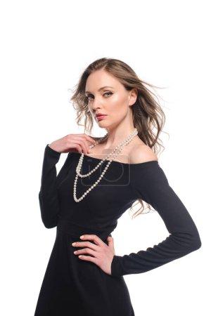 elegant woman in black dress posing isolated on white background